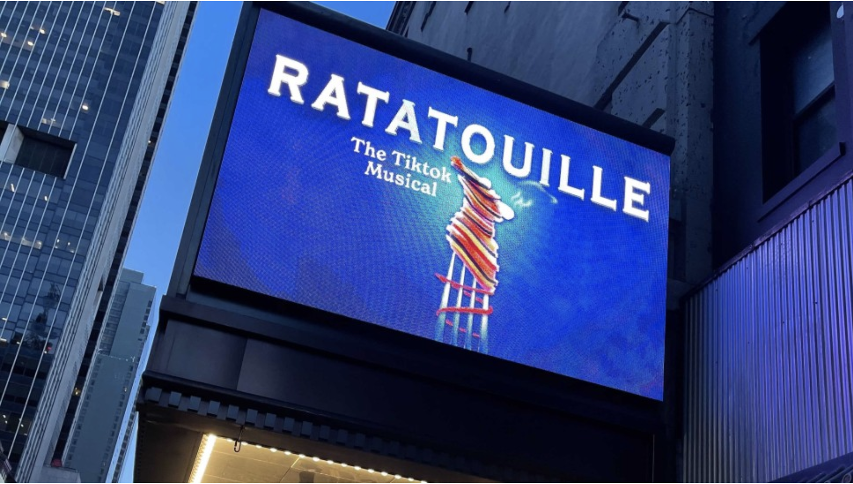 """A billboard on Broadway is lit up and reads """"Ratatouille: The TikTok Musical."""""""