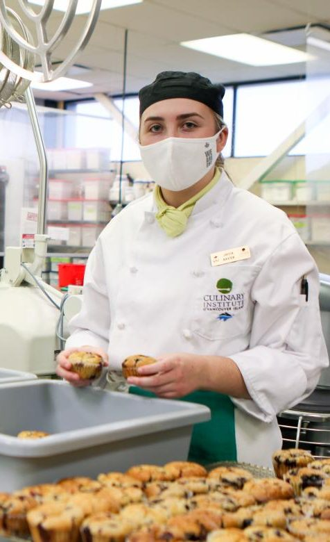 VIU Culinary Arts students pack baked goods into reusable containers for donation to Nanaimo Salvation Army meal centre