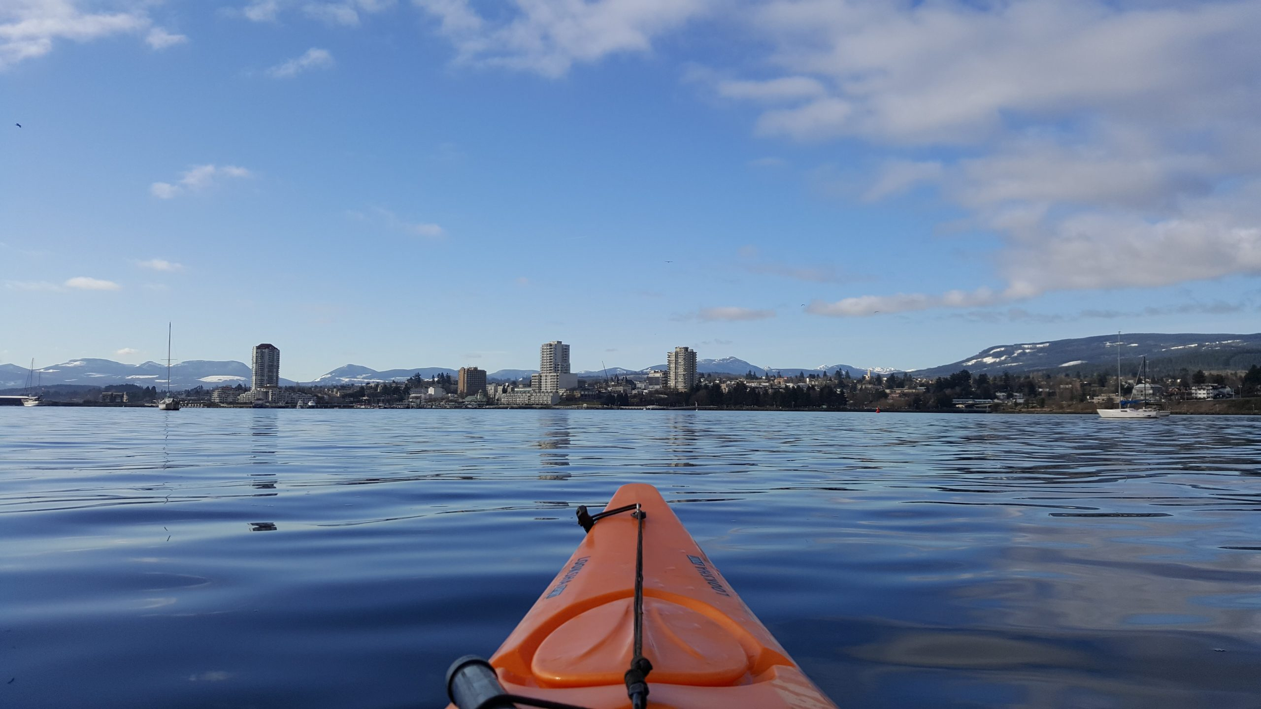 A perspective shot from a kayak, looking towards Nanaimo's downtown waterfront.