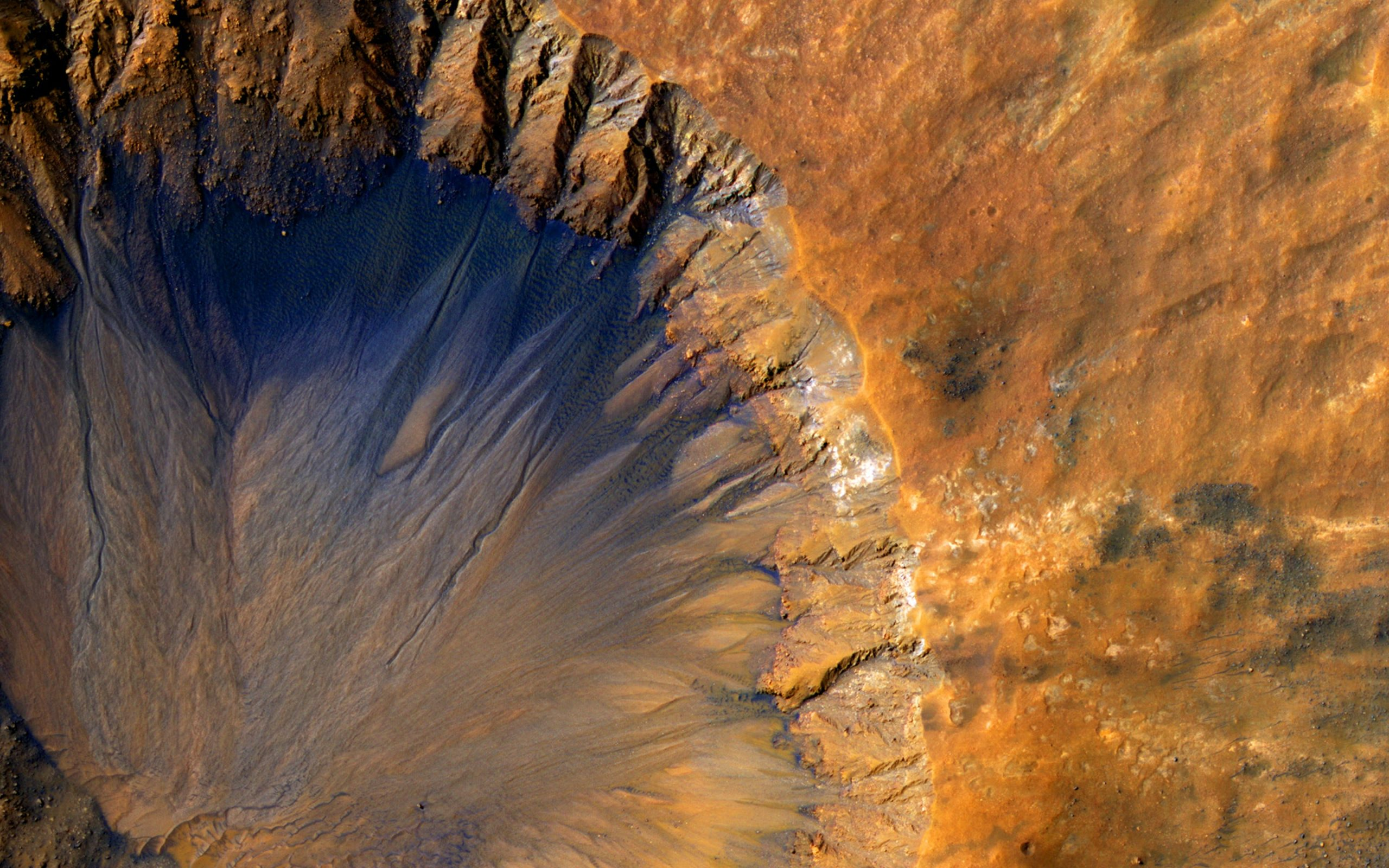 A satellite photo of the Sirenum Fossae, a large trough on the surface of Mars.