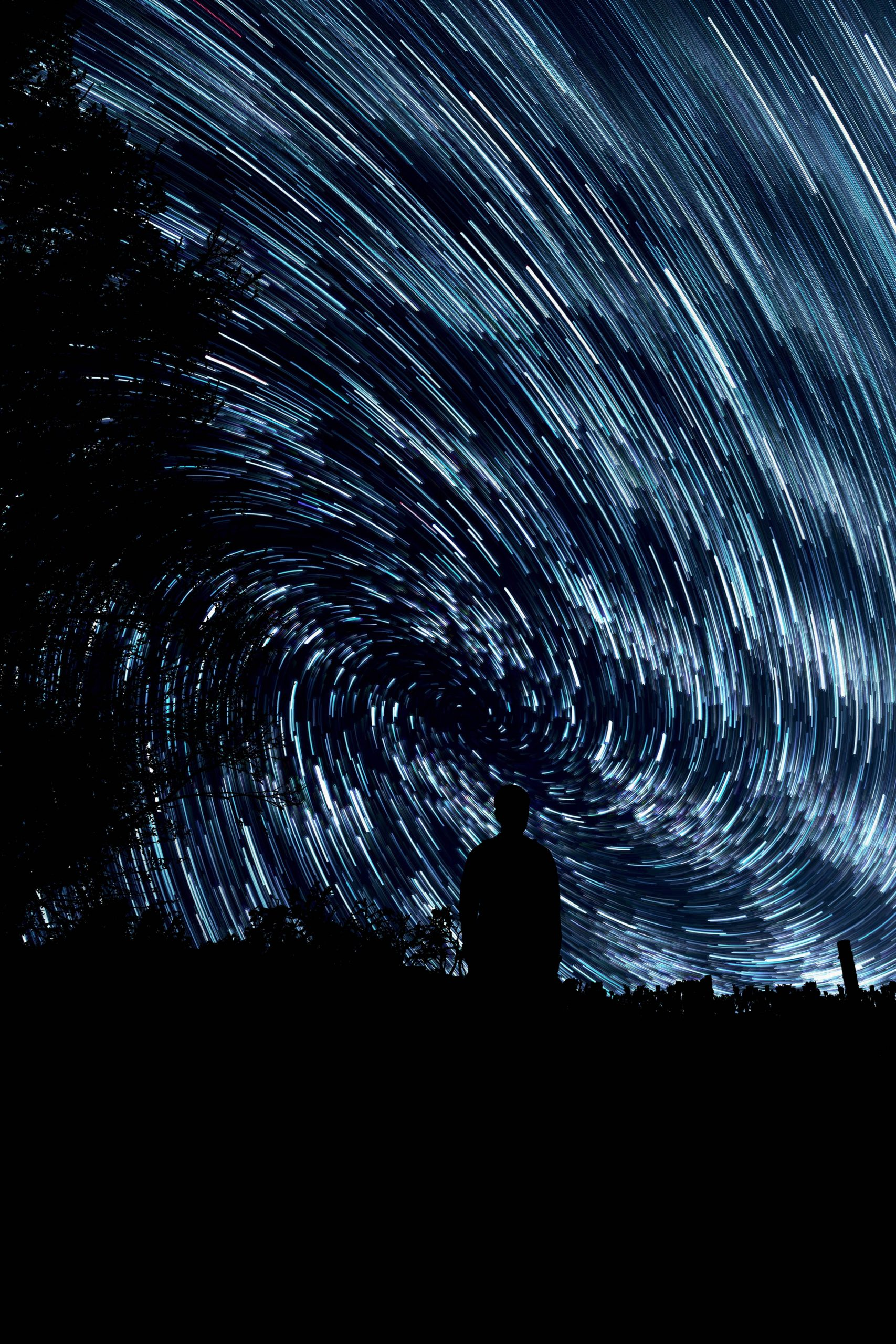 The blue sky is covered in bright stars that have been edited to swirl