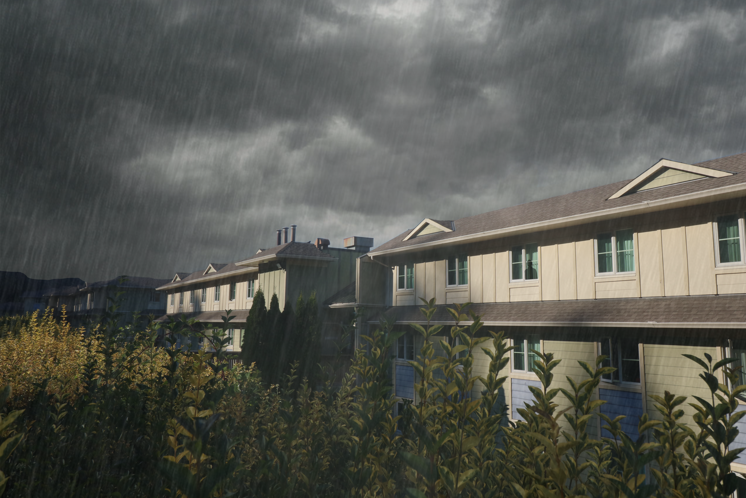 An edited photo of Building Two on the VIU Student Residence has a stormy grey sky