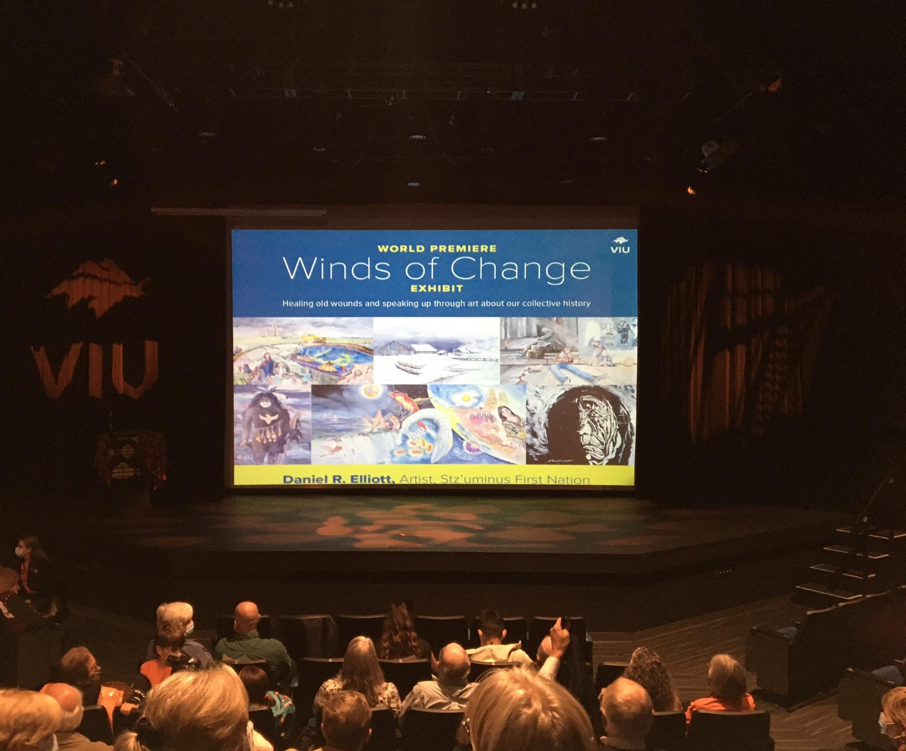 Image shows Winds of Changes poster on theatre stage