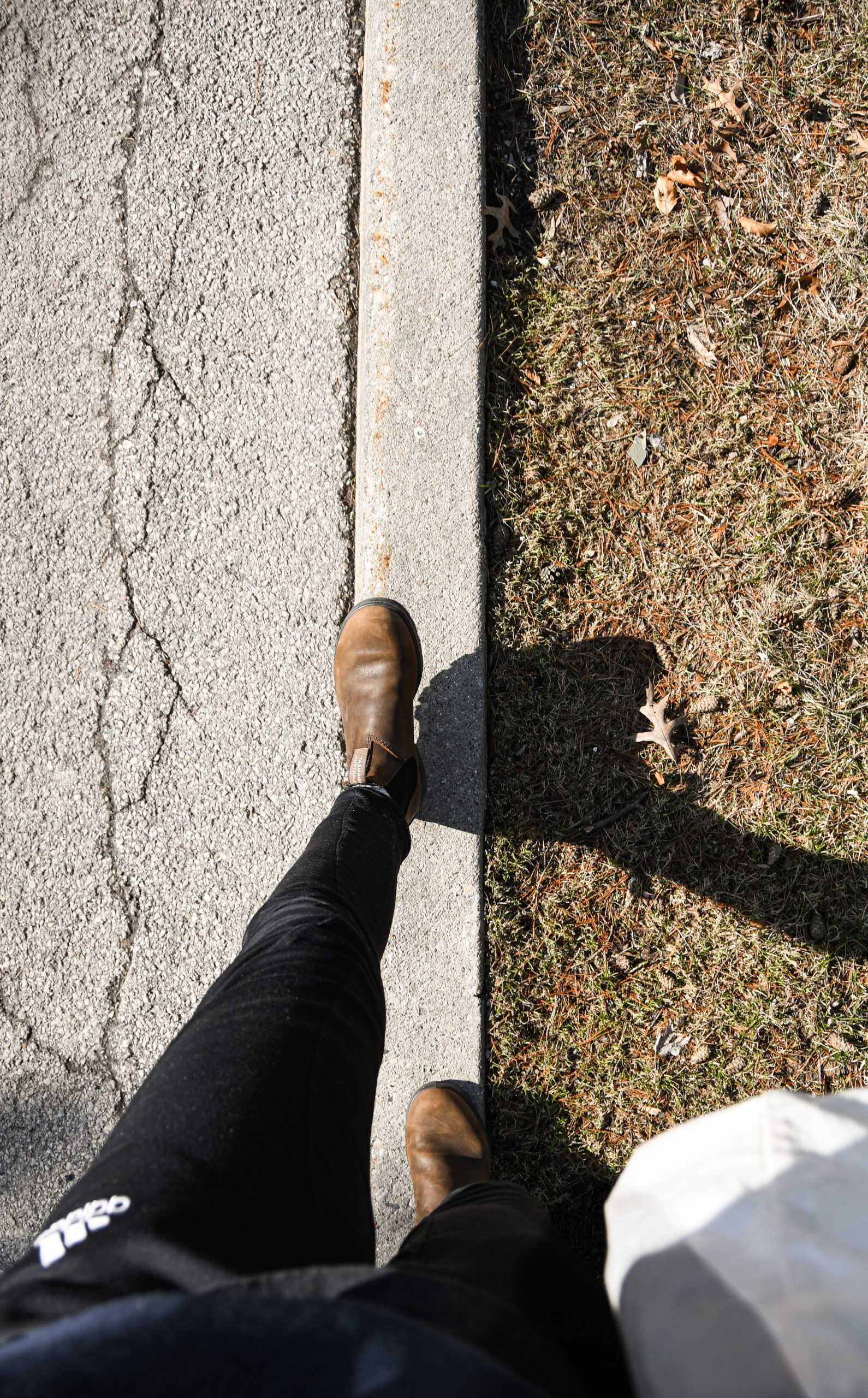 Image is of a person in blundstones walking